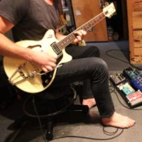 Ryan Axtell tracking guitars for Common Courier